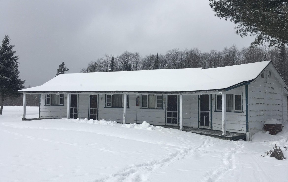 newly renovated home, workshop/garage and a 4 unit motel building all located on 1.5 acres.