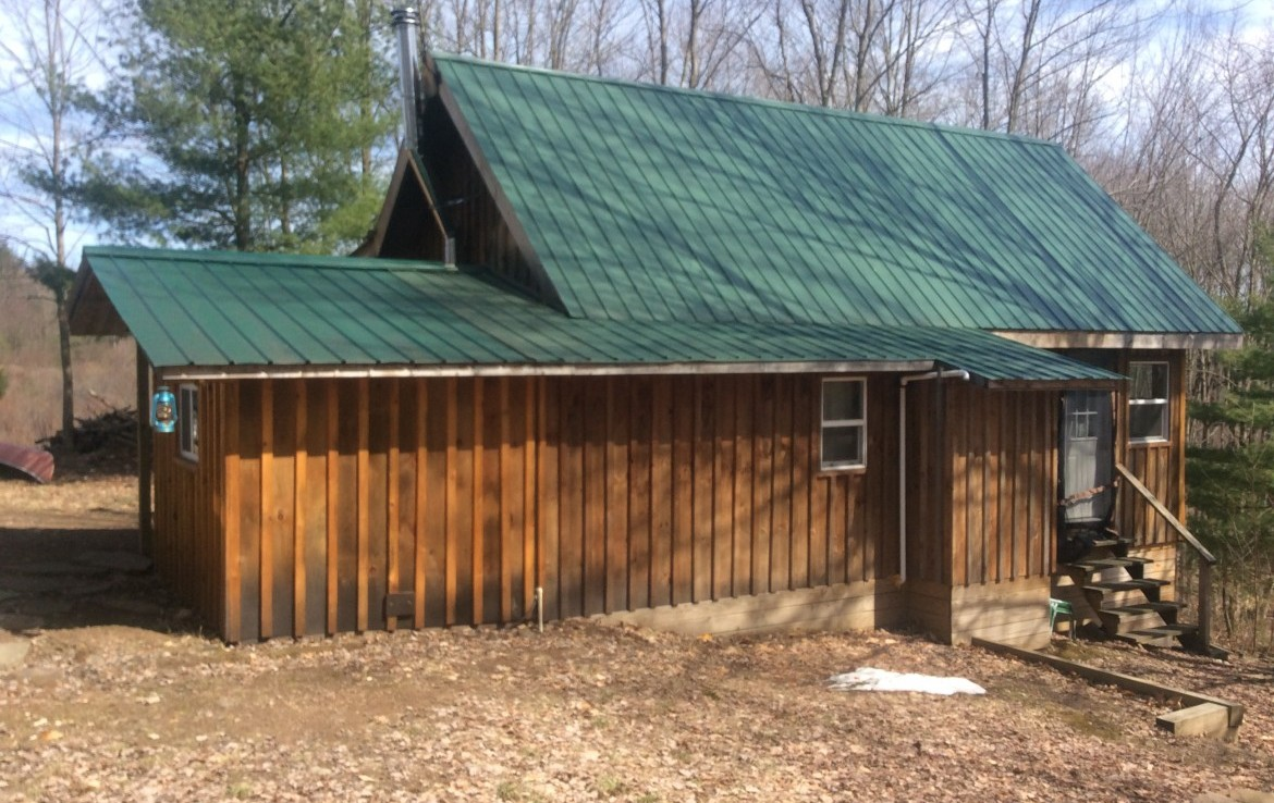 Secluded 5.4 acres Hunting Land with off-grid woodland cabin for sale in Amboy, NY!
