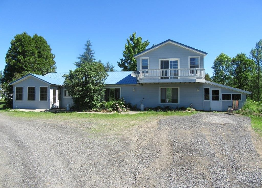 17 acres income producing farm land for sale with cash crops, farmhouse, second tenants home, large garage/shop and pond near St. Lawrence Seaway!