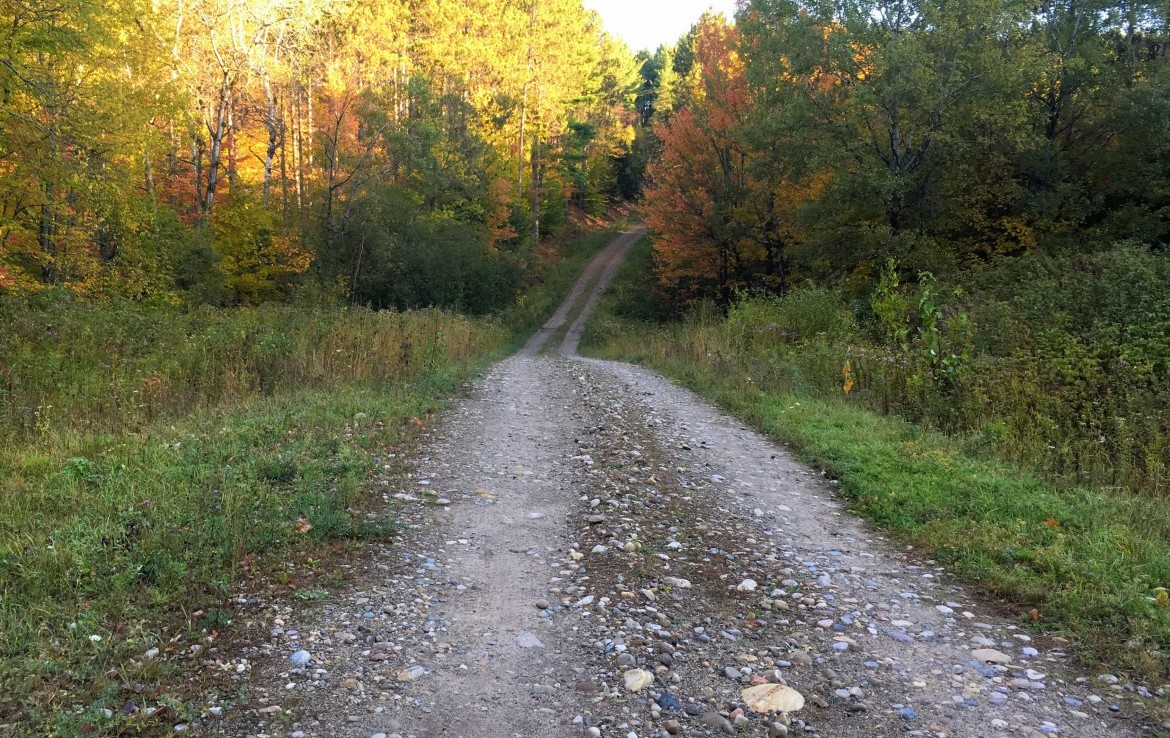 Access to the property is provided by a well built, private gravel road