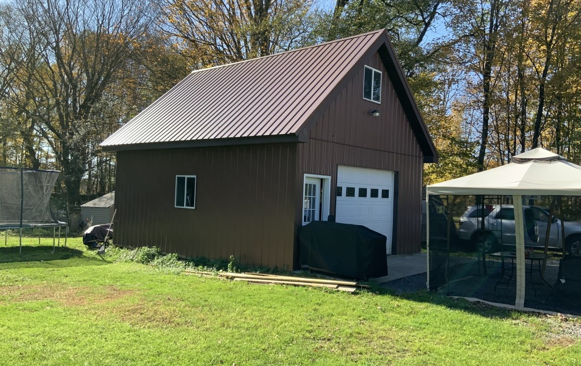 Large 20 x 24 (1.5 stories) pole barn with concrete floor and electric.....ideal for a shop