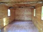 interior is finished in knotty pine with an oak laminate floor