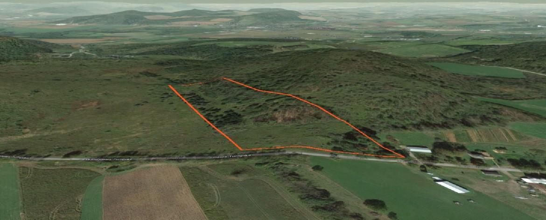 11 acres of mixed woodlands, brushland, and ridges.